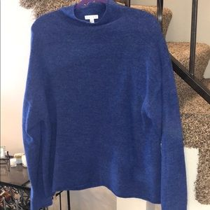 Soft and comfy acrylic blue mock neck sweater